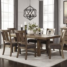 Features: -Assembled in the United States with Global Components. -Chairs included: No. Distressed: -Yes. Top Finish: -Brown. Base Finish: -Brown. Top Material: -Wood. Base Material: -Wood. Co