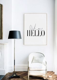 Understated living space with a playful typographic art piece