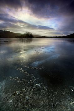 """Ice-lockedbyAlun Davieson 500px○Canon EOS 5D Mark II-f/19-1/6s-16mm-iso100, 1365✱2048px-rating:93.2☀""""Webbed footprints meander over the frozen water of Llyn Syfaddan / Llangorse Lake shortly after dawn..""""Photographer:Alun Davies,Cardiff,Wales"""