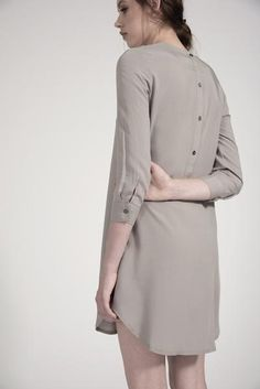 Backward Henley Dress by annotation It's so simple and classic, but what's this? Buttons up the back?  Yes, please. The reverse henley dress has a curved hem, not-quite-long sleeves and the brushed metal buttons add a little bit of extra interest to the rear closure. Keep the sun off your shoulders and show off your legs with this light, breezy summer dress. 100% Rayon