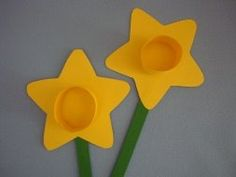 Daffodils - Allow children to cut the star shape (make large), make the center piece with yellow or white cupcake holders.  Attach pre-painted craft stick.