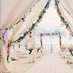 Nothing like walking down this ethereal aisle. | This Couple (And Their Guests) Renewed Their Vows At The Beach Wedding Of Your Dreams