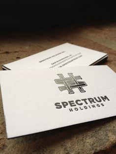 Spectrum Holdings business cards. One color letterpress with one color black foil stamp and painted edges. #businesscards #design #letterpress #logo #symbol #typography