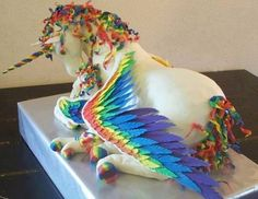 Unicorn Pegasus cake! The most beautiful 3D, creative & PERFECT cake I have EVER seen in my life! I don't think there could ever be a cake created more beautiful & more perfectly than this one! But, I'm also biased because a Unicorn Pegasus is my #1 favorite creature in the world (even tho its fictional fallowed by the White Siberian Tiger which IS real)! I want one EXACTLY like this for my next B-Day. But at the same time, it is way too beautiful & perfect to eat! What a dilemma!
