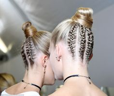 French braids: In keeping with their Parisian location, the models wore French braids to edge up their buns