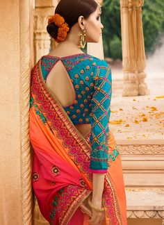 Contrasting hues put together to make a lovely designer sari! The blue and orange coloured half-and-half sari has colorful ethnic and floral patterns. A hint of pink on the pallu adds a further touch of liveliness to the vibrant drape. A blue silk blouse Sari Blouse Designs, Saree Blouse Patterns, Fancy Blouse Designs, Blouse Styles, Blue Silk Saree, Silk Sarees, White Saree, Orange Saree, Indie Mode
