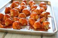 Spicy Buffalo Cauliflower Bites   1 cup water  1 cup all purpose flour  2 tsp garlic powder  22 oz (6 1/2 cups) cauliflower florets  3/4 cup Franks Hot Sauce  1 tbsp melted unsalted butter  Bake 450 for 20 mins, then add sauce & bake 5 more mins.