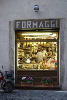 Formaggi (Cheese shop), Piazza di Trevi, Italy. Follow your nose -fresh fresh cheese - the thought makes me smile.