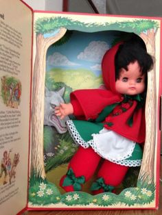 BURBANK VINTAGE BEAN DOLL DRESSED AS LITTLE RED RIDING HOOD WITH SLEEPING EYES.  DOLL IS FILLED WITH NON-TOXIC BEANS. ABOUT 10 INCHES TALL.
