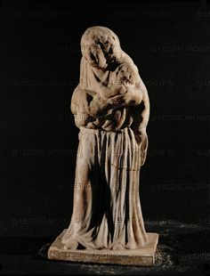 Nurse holding a child against her bosom. Terracotta figurine (last quarter 4th BCE) from Tanagra, Boeotia, Greece. Height 12.5 cm CA 2161 Louvre, Departement des Antiquites Grecques/Romaines, Paris, France