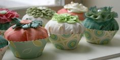 fabric cupcakes w/ paper wrappers.  Tutorial & pattern.