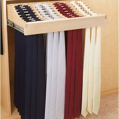 Pull-out rack can hold over 120 ties, belts or scarves and features full-extension slides and rubber o-rings to prevent slipping.