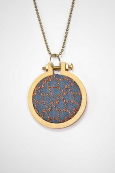 Copper! Some see tulips, some see chevrons but whatever you see, this little beauty is looking for an owner.  https://www.etsy.com/listing/215611211/hand-embroidered-mini-hoop-necklace-with?ref=shop_home_active_4