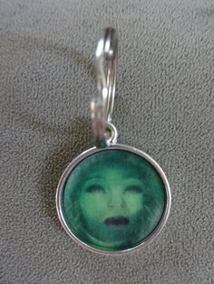 Haunted Mansion Madame Leota Key Chain by TicketTrinkets on Etsy, $12.00