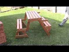 This is so cool. Folding bench becomes picnic table