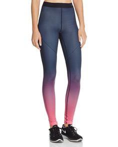 On your mark, get set, glow. Nike's striking ombre-fade leggings keep you cozy for cold-weather workouts with the label's Hyperwarm technology.   Polyester/spandex; lining: polyester   Machine wash  