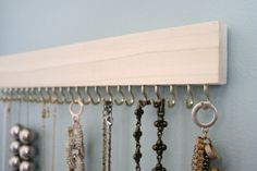 natural wood and brass hanging necklace display rack by fairlywell