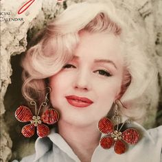 Wire Beaded Butterfly Earrings Bugle beads threaded and wrapped around a butterfly wireframe. Rhinestone floral center.    J hook. 3 inches long, 2 inches wide. Fashion/Costume. I saw another Posher display earrings in this way, it was clever..wish I could remember who and give her a shout out. Not sure Its OK to use Marilyn's likeness??? No brand Jewelry Earrings