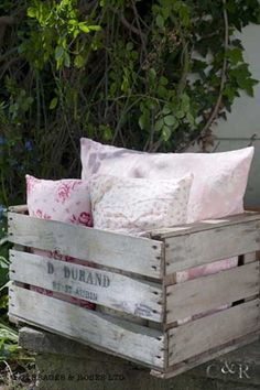Pink pillows in white crate