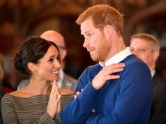 Prince Harry and Meghan Markle admire the interior of the banqueting hall during a visit to Cardiff Castle, January 2018