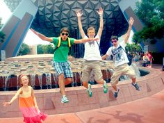 "The kids doing their best ""High School Musical"" jump in front Spaceship Earth!"