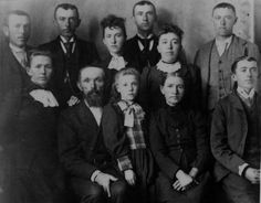 """Photo of the Carl William Alberding family, taken appoximately 1895 (ages are also approximate). Rear (L. to R.): Charles Julius """"Jule"""", 24; Henry, 28; Leah, 17; Lewis """"Lew"""", 26; Lucy, 22; Will, 20 Front: Ermina """"Minnie"""", 30; Carl William (father), 61; Martha, 11; Mary (mother), 52; Edward, 22. Abt 1895, Clay Center, Clay, Nebraska"""