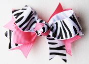 Have you seen our new bows?  They are soo sweet!  Every little girl needs a little zebra in her hair accessories. $1.99 at wholesaleprincess. com where adorable meets affordable.