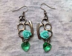 Silver Brass Knuckle Earrings with Green Rose by Hankat on Etsy, $16.00