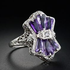 Unique Amethyst ring, one swiss cut diamond, 0.03 ct, VS/I-J and 6 baguette cut amethysts, 1.0 tcw. 18 carat white gold, filigree. Undated, presumed vintage