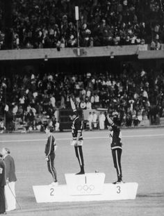 The True Stories Behind 8 Of History's Most Famous Pictures: John Carlos and Tommie Smith on the medal stand, October 19, 1968