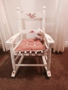 Small child's rocking chair.  Spray painted with white satin, decoupage flowers & bird & then clear varnish to protect.