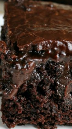 Chocolate Poke Cake from scratch ~ One of the most amazing and moist cakes you'll ever have... A secret ingredient brings out the chocolatey goodness!