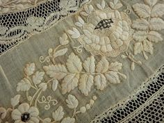 Noticeable yellowing but still beautiful embroidery; net lace | Eglantyne