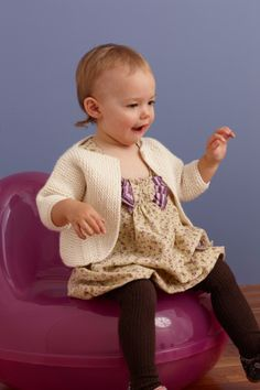 This knit cardigan is simple and stylish, perfect for well-mannered tots.