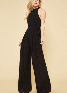 e00d2553b9db Sleeveless Jumpsuit in Black by Promesa. Wide PantsBlack Halter  JumpsuitJumpsuit OutfitHigh ...