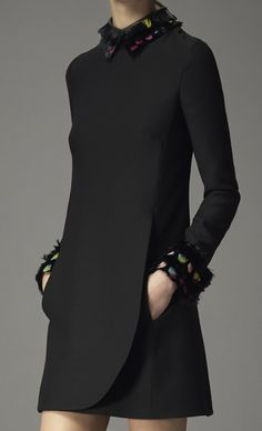 Minimal black dress with clean structured silhouette, accented with feather collar & cuffs - elegant simplicity // Valentino