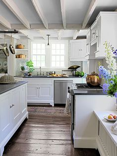 Loving this kitchen's exposed joists and wide-plank floors!