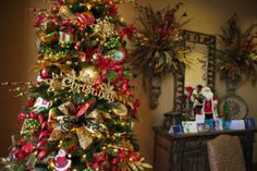Christmas Decorating-TIP for Decorating a business- Elements used on the tree such as gold glitter leaves, balls, sprays, and ribbon were added to the everyday floral  (already at the office) to give the theme of happy holidays.