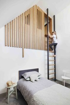 Coppin Street Apartments By MUSK Studio This modern kids bedroom has a loft area is reached via a ladder, with the loft partially hidden by wood slats. Source by auliazch. Mezzanine Bedroom, Bedroom Loft, Bedroom Decor, Bedroom Storage, Bedroom Colors, Mezzanine Loft, Design Bedroom, Lego Bedroom, Attic Bedrooms