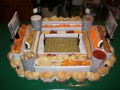 Towers of snacks are what dreams are made of. | 21 Incredible Football Stadiums Made Of Snacks