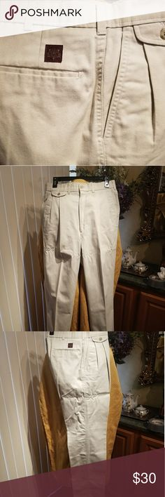 RARE SIZE 34LONG  Haggar classic fit  khakis Classic fit, pleated front with faux buttoned pocket on right hip.   Rare 32X34 size Haggar Pants Chinos & Khakis