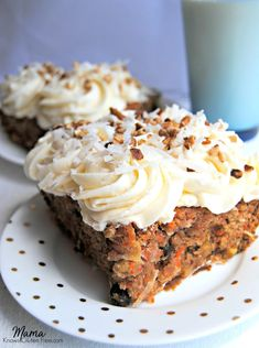 An incredibly moist and deliciously spiced gluten-free carrot cake recipe with an oh-my-goodness cream cheese frosting. This will be a family favorite!