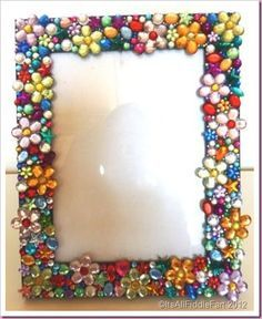 Ganz simpel selber zu machen. Einen einfachen Holzrahmen besorgen und halbierte Glasperlen (Bastelladen) mit eienm Glaskleber aufkleben:) jewelled photo picture frame