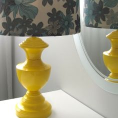 Revamp your old brass lamp with a bit o spray paint and fabric!