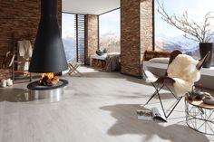 schönes Wohnzimmer mit Designboden von planeo - www.planeo.de #livingroom #vinylboden #modern einrichten