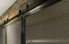 Black-stainless track door hardware with lightweight Stainless doors. Sliding Shed Door, Sliding Barn Door Hardware, Wood Front Doors, Double Barn Doors, Barn Door Window, Track Door, Sliding Door Window Treatments, Barn Door Designs, Interior Barn Doors