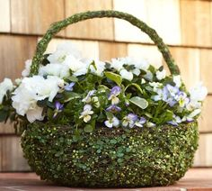 Pottery barn basket. 50. Its wrapped in fake vines. Easy to reproduce and I love pansies. I wonder if Michaels has skinny vine...