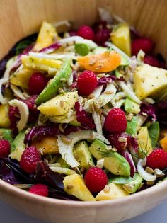 Summer Salad with Sunny Citrus Dressing | Salad: Romaine with raspberries, pineapple, avocado, fennel, radicchio. | Dressing: Orange juice, lemon, coriander, pepper, olive oil.