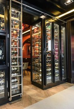 Possibly incorporate an extra layer of wine in front of the glass like this? Walk through ? Restaurant Bar, Decoration Restaurant, Restaurant Concept, Restaurant Design, Cave A Vin Design, Buddha Bar, Alcohol Cabinet, Wine Cellar Design, Beer Shop