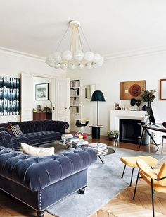 Urban chic living room of the trendy Paris apartment - Decoist